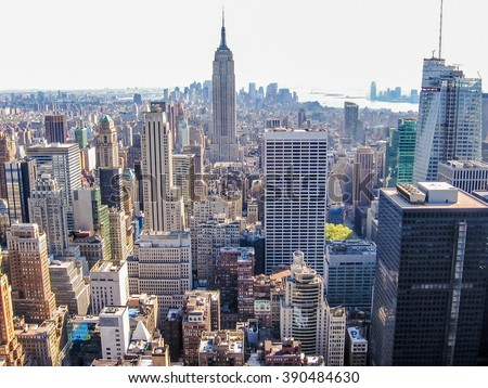 Manhattan, New York, United States - April 29th, 2008: horizontal cityscape of New York City from the Top of the Rock at Rockefeller center with Empire State Building - stock photo
