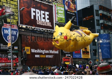 MANHATTAN - NOVEMBER 26 : Pikachu balloon passing Times Square at the Macy's Thanksgiving Day Parade November 26, 2009 in Manhattan.  - stock photo