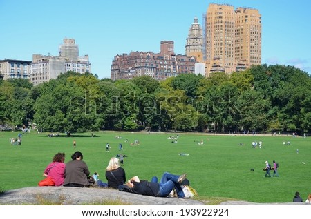 MANHATTAN, NY- SEPTEMBER 21: Central Park in New York, USA on September 21, 2013. One of the 5 boroughs of New York City, the smallest but also the most populated. - stock photo
