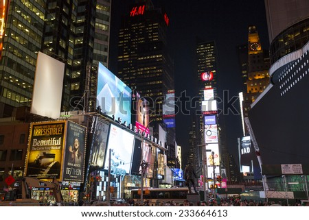 Manhattan, NYC - November 3: View of tourist packed Times Square by night, in Manhattan, NYC on November 3, 2014.