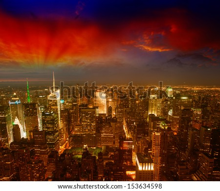 Manhattan, NYC. Spectacular sunset view of Bryant Park and Midtown from the top of Empire State Building. - stock photo