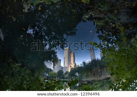 Manhattan, reflected in the puddle and inverted. - stock photo