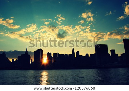 Manhattan silhouette skyline at sunset - stock photo