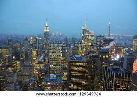 Manhattan Skyline and Empire State Building, viewed from Rockefeller Plaza at night, New York City, USA