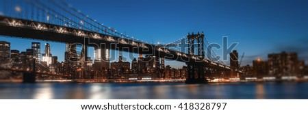 Manhattan Skyline and Manhattan Bridge At Night. Defocused image with blurred edges and  foreground. Romantic view with lights and bokeh