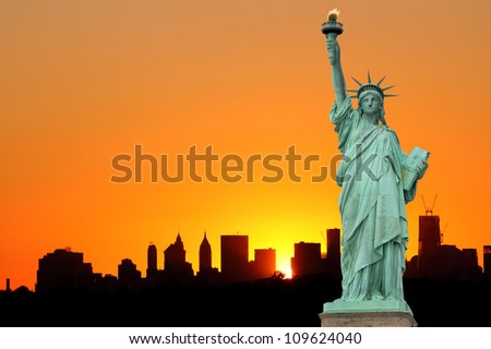 Manhattan Skyline and The Statue of Liberty at Sunset, New York City - stock photo
