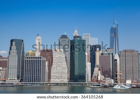 Manhattan skyline from promenade on Brooklyn side - New York, NYC - stock photo