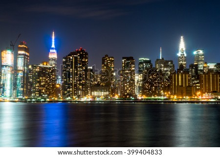 Manhattan skyline in New York City at night from across the East River