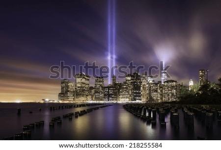 Manhattan skyline on 9-11-2014, memorial lights - stock photo