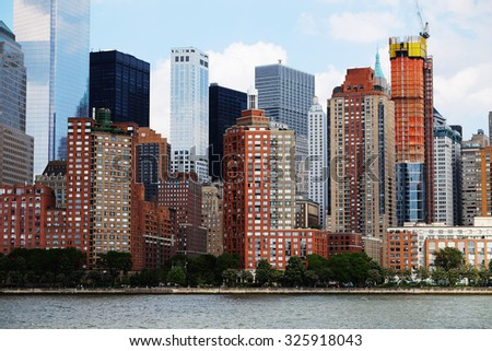 Manhattan skyline over Hudson River, New York, USA. Manhattan downtown view with skyscrapers, NYC panorama. Top of the buildings in financial district. Business background.