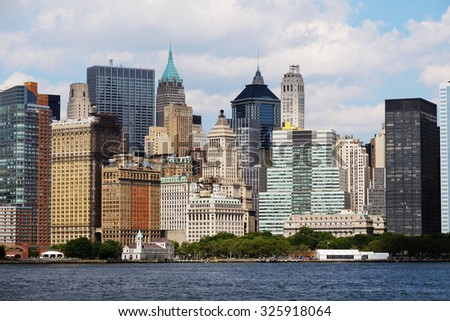 Manhattan skyline over Hudson River, New York, USA. Manhattan downtown view with skyscrapers, NYC panorama. Top of the buildings in financial district. Business background. NY skyscrapers. - stock photo