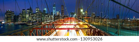 Manhattan skyline panorama from Brooklyn Bridge at dusk, New York City
