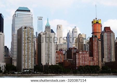 Manhattan skyline panorama over Hudson River, NYC. Midtown view with big skyscrapers, New York City, USA. Top of the buildings in financial district. Business background. NY skyscrapers. - stock photo