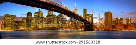 Manhattan skyline panorama with Brooklyn Bridge at dusk, New York City