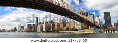 Manhattan skyline panorama with Queensboro Bridge over East River, New York