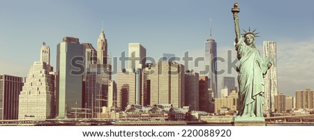 Manhattan Skyline with Brooklyn Bridge and the Statue of Liberty, New York City  - stock photo
