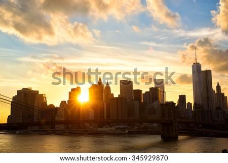 Manhattan skyline with Brooklyn Bridge at sunset, New York , United States - stock photo