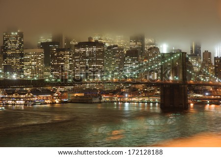 Manhattan skyscrapers and Hudson River at night