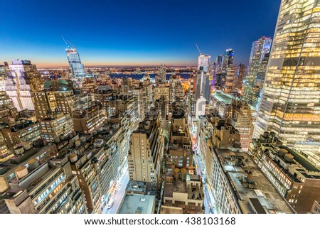 Manhattan skyscrapers at night as seen from New York rooftop. - stock photo