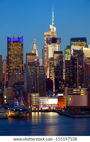 Manhattan urban skyscrapers at dusk, New York City - stock photo