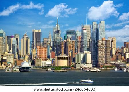 Manhattan urban skyscrapers over Hudson River, New York City - stock photo
