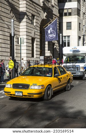 Manhattan, USA - November 4: View of a traditional NYC cab in Manhattan, USA on November 4, 2014. - stock photo
