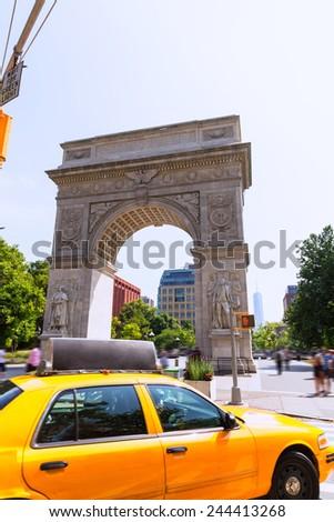 Manhattan Washington Square Park Arch and yellow cab in New York City USA - stock photo