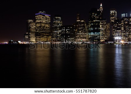 Manhattan with all his skyscrapers and hudson river photographed by the night