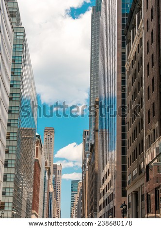 Manhattan. Wonderful view of tall skyscrapers from street level on a sunny day.