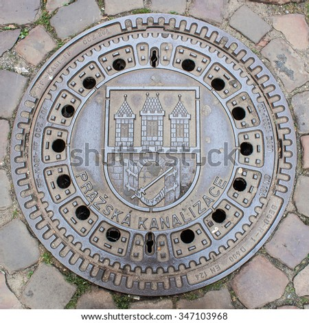 Manhole cover featuring Prague coat of arms