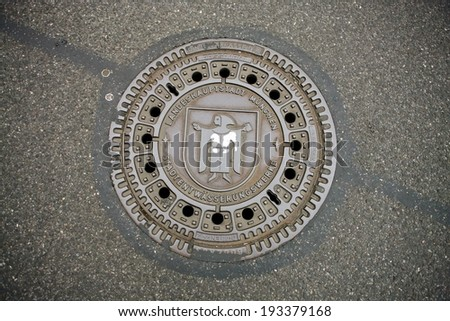 manhole cover in Munich, Germany - stock photo