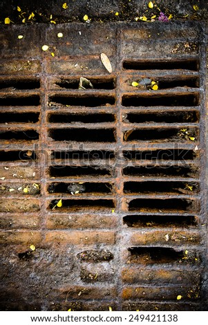 Manhole cover metal blockages and rust. - stock photo