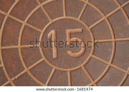 Manhole number 15 - stock photo