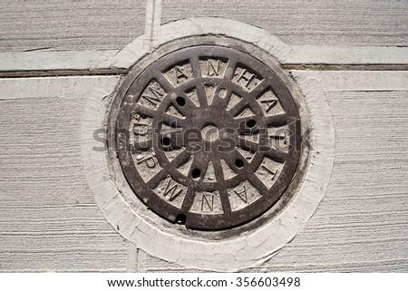 Manhole of the Manhattan sewage system in New York City - stock photo