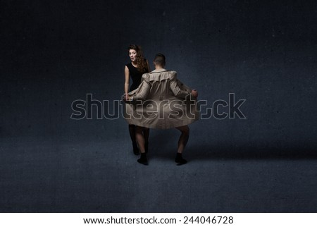 maniac opening jacket in front of a poor woman - stock photo