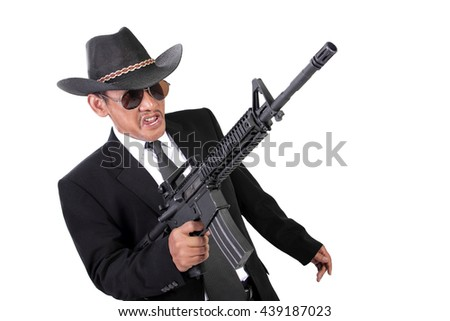 Maniacal expression of an old gangster in a battle, with his gun pointing up, isolated on white background