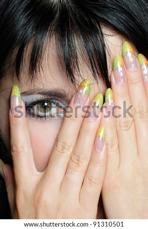 manicure and makeup in a beautiful brunette - stock photo