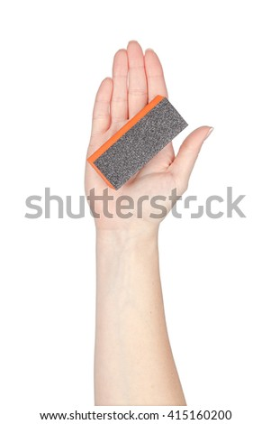 manicure and pedicure nail file in a hand isolated on white background. cosmetic tool