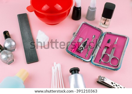 Manicure and pedicure Set on Pink Background.