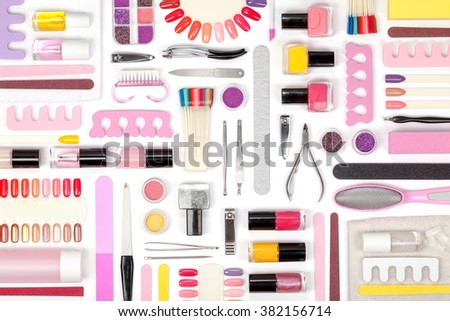 manicure and pedicure tools and other essentials on white background top view. flat lay composition in pink and yellow colors - stock photo