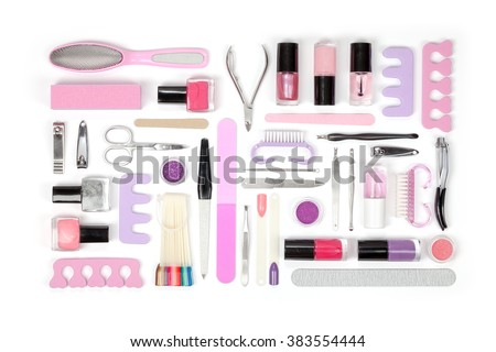 manicure and pedicure tools and other essentials on white background top view. nail work flat lay concept in pink colors - stock photo