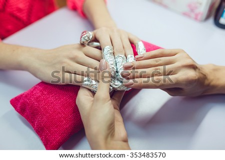 Manicure. Beauty saloon. Close-up. Remove old nail polish. - stock photo