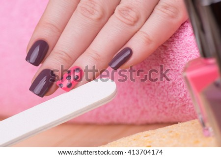 Manicure - Beauty treatment photo of nice manicured woman fingernails. Very nice feminine nail art with nice pink and purple nail polish. Selective focus. - stock photo