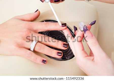 manicure, care of fingers of hands, cleaning, covering a varnish of nails