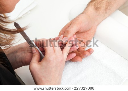 Manicure close up in manicure room - stock photo