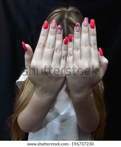 manicure fingernails hands on a black background - stock photo