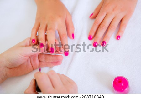 manicure, girl doing manicure in beauty salon, close-up - stock photo