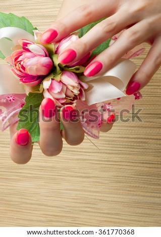 Manicure, Hands spa Beautiful feamle hands, soft skin, beautiful nails with pink rose flowers petals. Healthy Woman hands. Beauty salon. Beauty treatment. Beautiful nails with  manicure