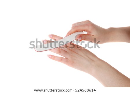 Manicure. Hands with the nail file on the white background