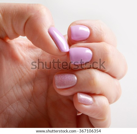 Manicure on pink nails, Finger nail treatment - stock photo